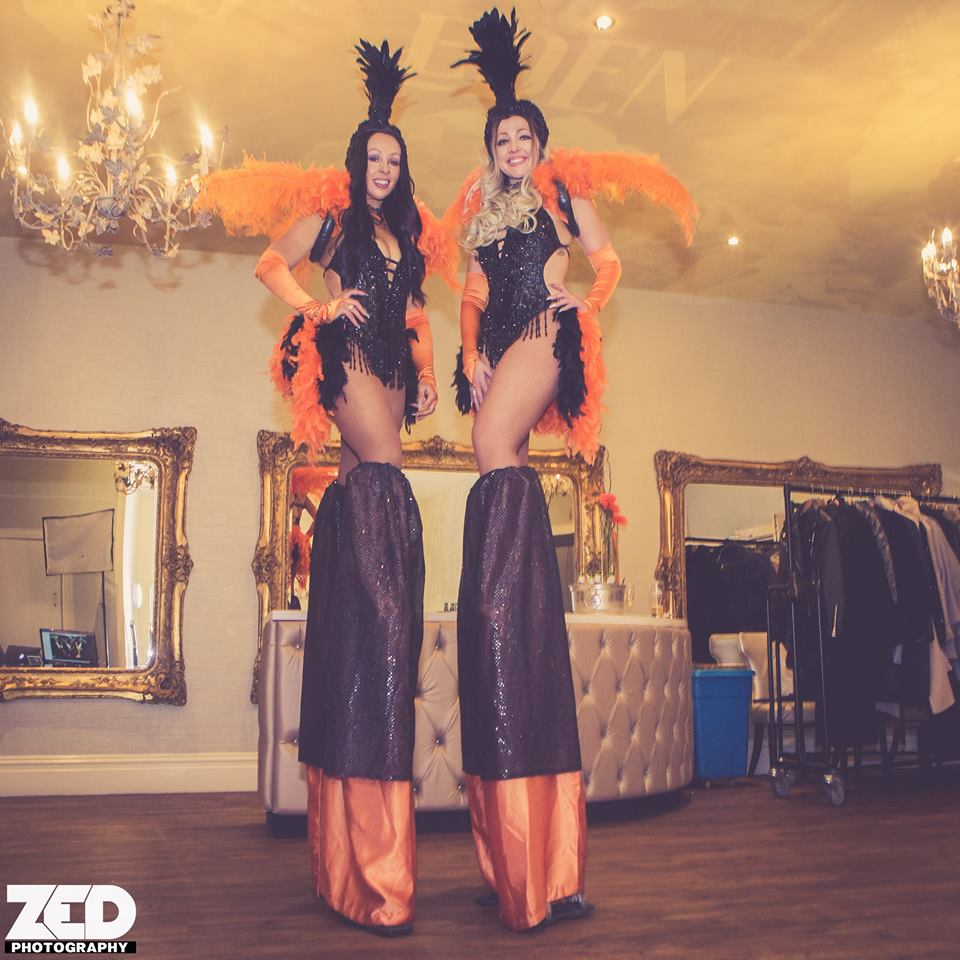 Las Vegas Feather Showgirl Stilt Walkers for hire in the UK